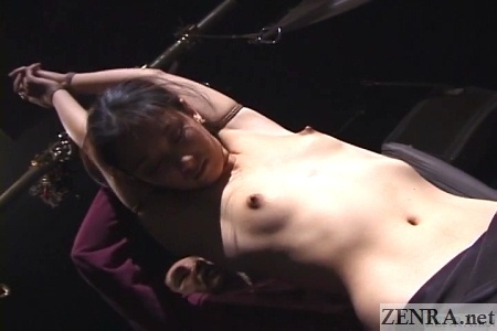 topless japanese woman bound hands in air