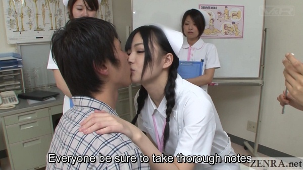 pale japanese nurse kisses patient with audience