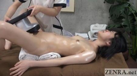 vibration machine used on naked customer at massage clinic