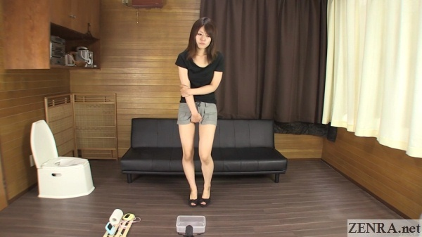 japanese woman tries to hold in pee while standing