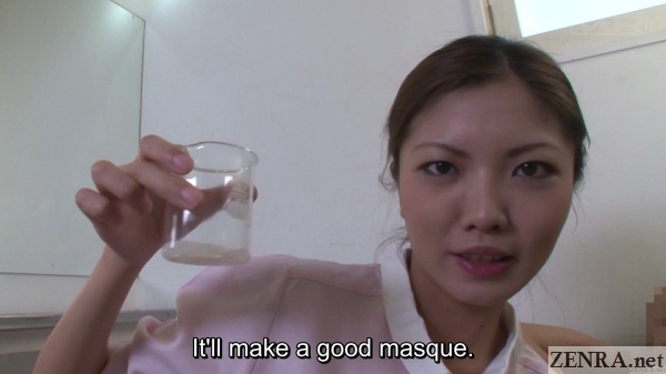 japanese massage therapist holds beaker full of semen