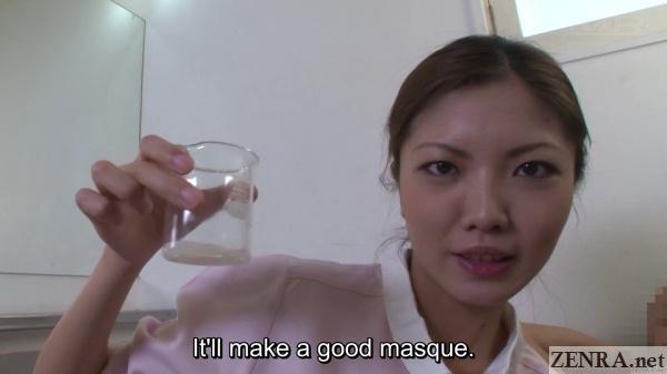 japanese massage therapist holds beaker full of semen
