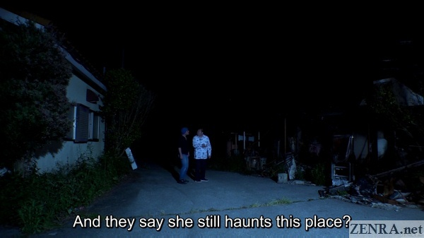 japanese ghost hunters look for wide eyed woman