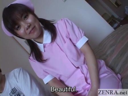 japanese nurse sitting on bed