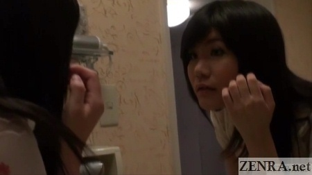 post makeup yuuko admires herself in mirror