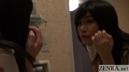 post makeup yuuko admires herself in mirror