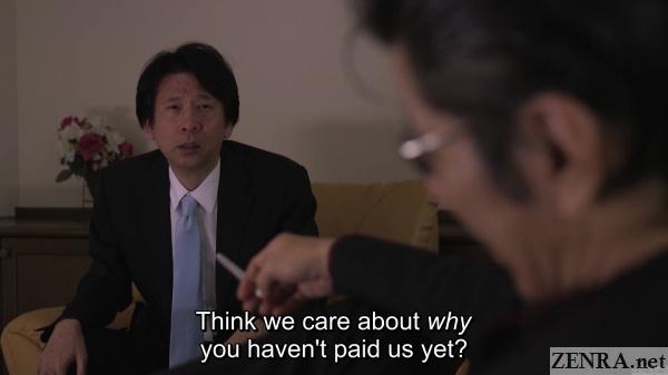 distraught japanese businessman with yakuza