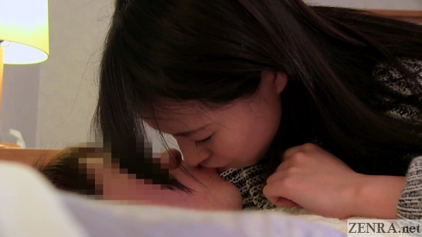 kissing japanese couple at love hotel