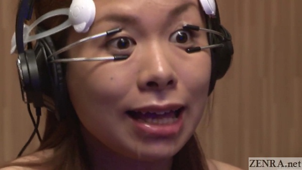 japanese woman eyes held open by strange device close up