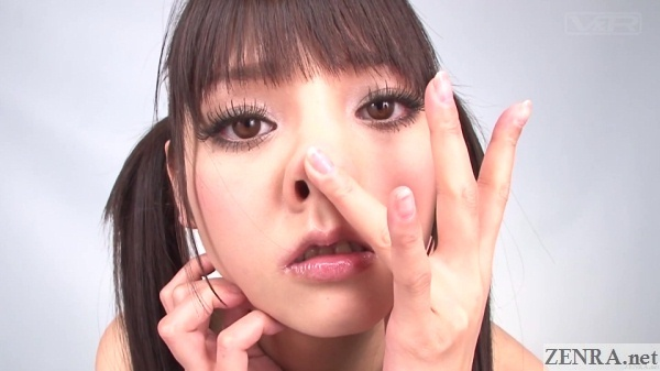 rei mizuna plays with nose