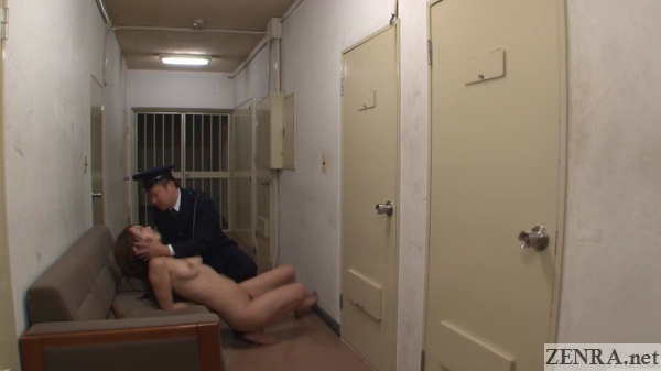 clothed guard with naked female prisoner