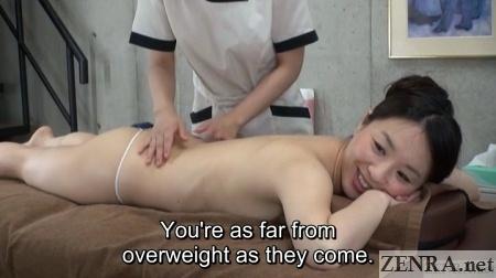 prone pale japanese woman awaits massage to start