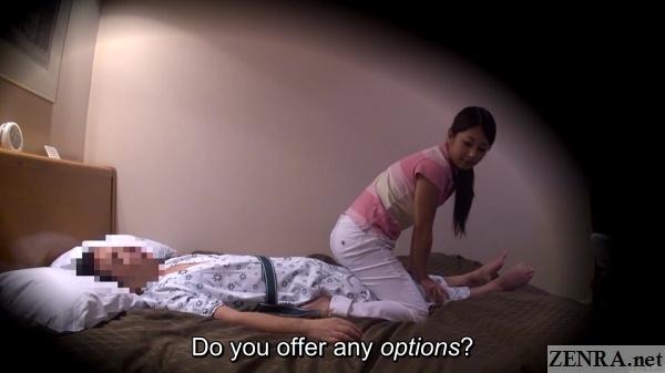 masseuse sits on supine client for leg massage