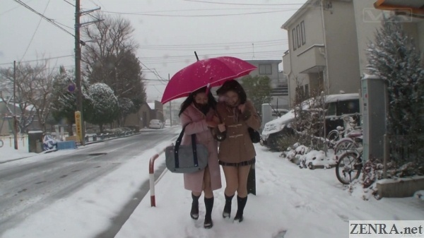 japanese schoolgirls on a snowy day outside