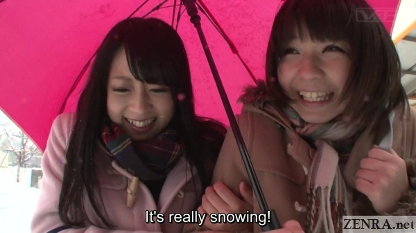 schoolgirls out on snowy day
