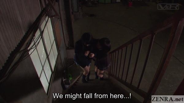 schoolgirls climb stairway in factory