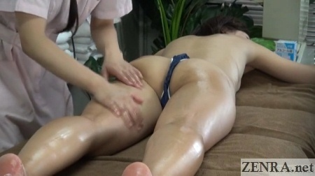 close up prone female customer in thong receives massage