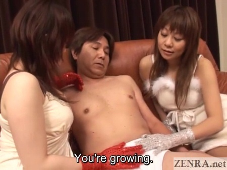 gloved japanese woman on sofa with masochistic man