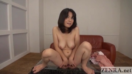 busty japanese woman naked squatting on table