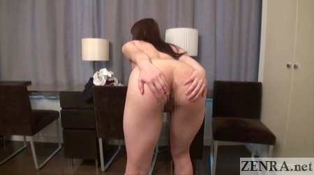 naked japanese woman bends over and spreads butt