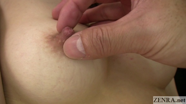 close up squeezing pink japanese nipple