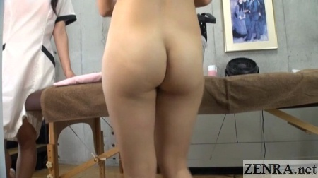 butt of stark naked japanese customer about to get massage