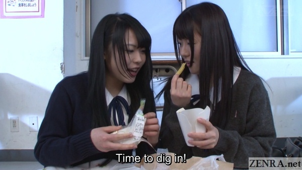 japanese schoolgirls eating in classroom