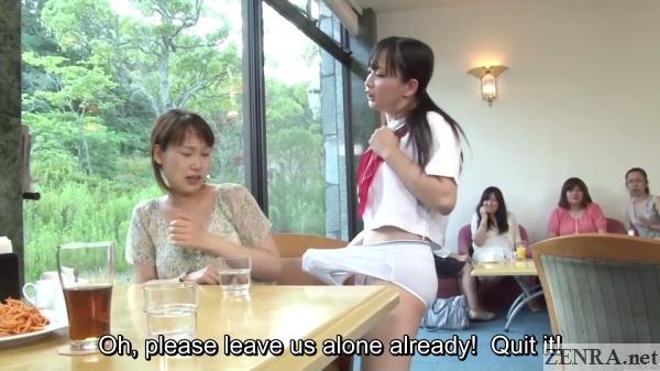 playful schoolgirl in underwear teases cafe customer