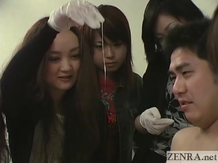 lewd japanese women holds up cum