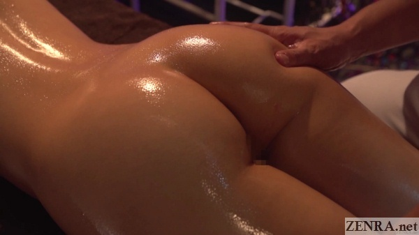 close up oiled up japanese butt massage