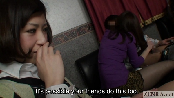 japanese girlfriend watches jav star give boyfriend a handjob