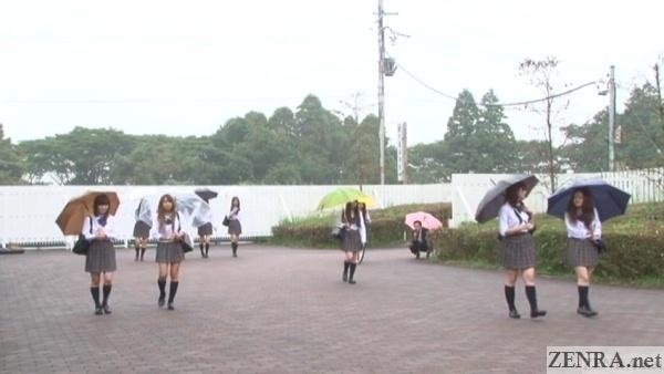 japanese schoolgirls on a rainy day