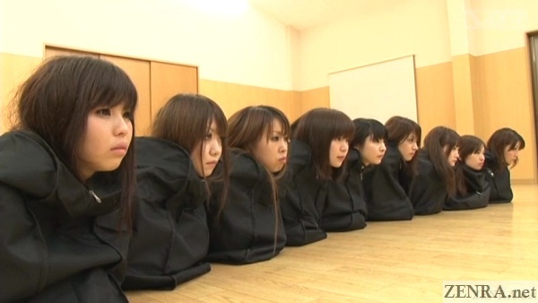 schoolgirls head sticking out of bags