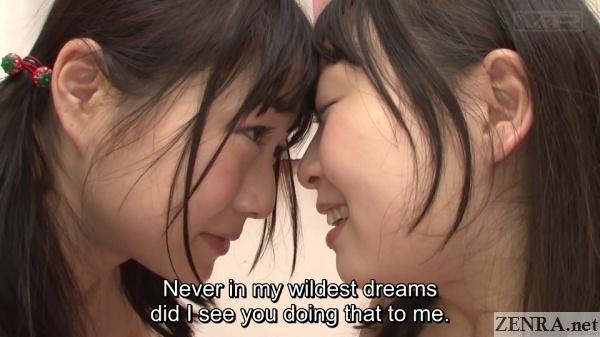 elated japanese lesbians face close up
