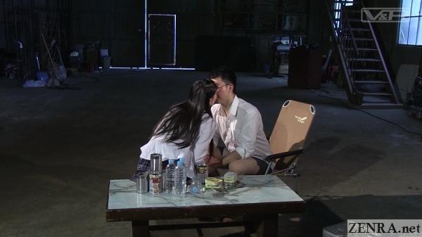 kissing japanese schoolgirl in big empty factory